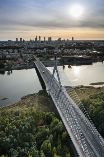 Skyline of Warsaw city, Poland during sundown with modern bridge